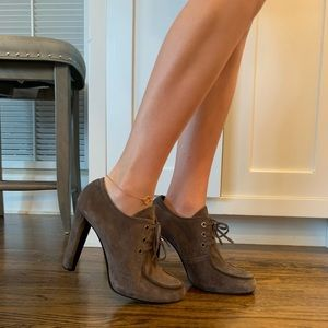 Stuart Weitzman lace up booties. taupe
